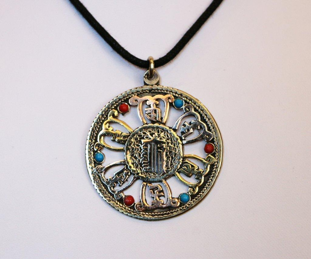 Authentic Tibetan Kalachakra Pendant worn to reduce suffering.