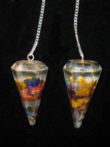 Resin Orgone pendulum with gemstones and copper.