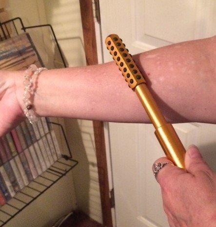 Demonstration of Scalar Energy Wellness Roller on arm