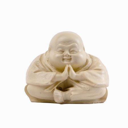 White buddha sitting and meditating