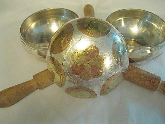 Bottom of three metal tibetan singing bowls