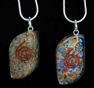 Spiral Orgone Pendant. Resin pendant with gemstones and copper and 18 inch snake chain
