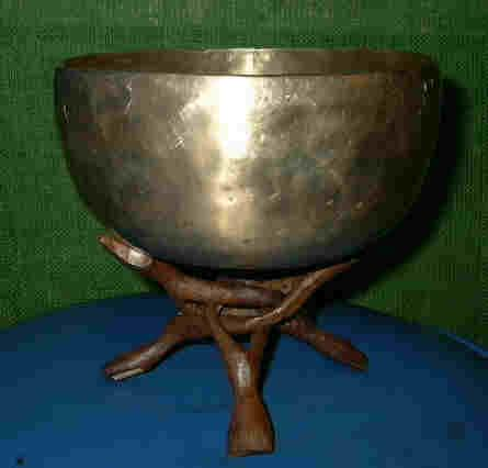 Hand hammered singing bowl on wood tripod stand
